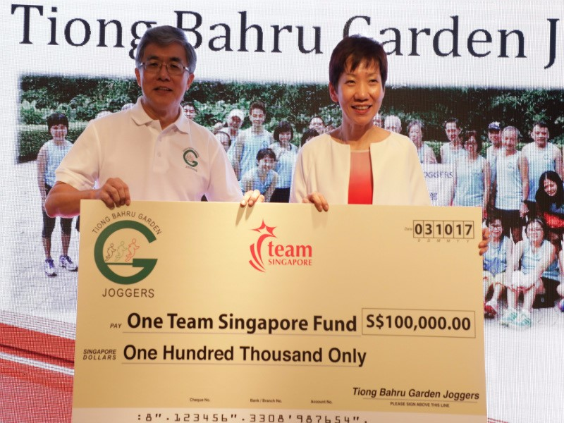 Tiong Bahru Garden Joggers presenting donation to OTSF to Minister Grace Fu