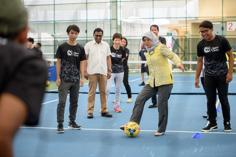 President Halimah making a penalty kick at the Temasek Foundation Cares - Play-Ability programme launch